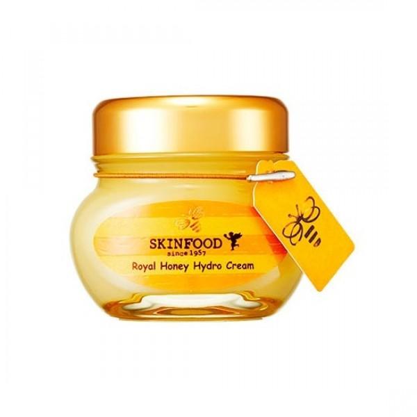 крем для лица с маточным молочком и черным медом skin food  royal honey good hydro creamROYAL HONEY GOOD HYDRO CREAM. Крем для лица с маточным молочком и черным медом<br><br>СРОК ГОДНОСТИ 2017.08<br><br>Легкий, с гелевой текстурой и ненавязчивым медовым ароматом, этот крем придется по душе тем, кто хочет получить от крема интенсивное увлажнение и питание кожи. Похожий на очень светлый сорт меда, крем тает на коже, быстро впитывается и обеспечивает 100-часовое увлажнение! Крем прекрасно подходит для любого типа кожи, но особенно необходим он сухой, очень сухой и шелушащейся коже. Даже зимой, в холодный и ветреный день, это средство защитит кожу, сохранив оптимальный гидро-баланс.<br><br>В составе крема экстракты королевского черного меда и маточного молочка, добытые трудолюбивыми пчелками в экологически чистых, признанных объектом всемирного наследия ЮНЕСКО, лесах Восточной Азии. <br><br>Черный королевский мед – это источник огромного количества питательных компонентов, которые оказывают на кожу поистине чудесное воздействие. Натуральный природный антисептик, оказывая бактерицидное действие, предупреждает развитие бактерий, возникновение раздражений, покраснения кожи, появление зуда и других неприятных ощущений.&amp;nbsp;<br><br>Также в составе Royal Honey Hydro Creamматочное молочко – не менее целебный компонент, особенно для увядающей кожи. Это&amp;nbsp;мощный антиоксидант, укрепляющий клетки кожи, оказывающий общее восстанавливающее действие, обеспечивает легкий лифтинг-эффект, разглаживая кожу, делает морщины менее заметными, омолаживая, улучшает цвет лица.<br><br>Помимо увлажнения, крем питает и смягчает кожу, устраняет сухость и шелушения, глазирует кожу, делает ее гладкой, шелковистой, сияющей, визуально сглаживает сеточку морщинок, а при регулярном применении способствует ее полному устранению. Еще одна особенность крема – его натуральность, в его составе НЕТ минеральных и силиконовых масел, талька, триклозана, триэтаноламина и других компонентов, способных в