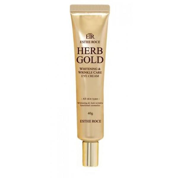 крем для век омолаживающий deoproce estheroce herb gold whitening &amp; wrinkle care eye creamEstheroce Herb Gold Whitening &amp;amp; Wrinkle Care Eye Cream. Крем для век омолаживающий<br><br>Кожа век, практически лишенная сальных и потовых желез, очень часто испытывает недостаток увлажнения, становится сухой и вялой, истончается, появляются морщины, а неблагоприятное воздействие окружающей среды и других внешних факторов приводит к появлению темных кругов и пигментации.<br><br>Премиум-линия средств для омоложения кожи помогает справиться с возрастными изменениями, оказывает целенаправленное воздействие на осветление пигментации и разглаживание морщин. Средства улучшают внешнее состояние кожи, воздействуя на процессы омоложения на клеточном уровне, стирая с лица следы усталости и возрастные изменения.<br><br>Основные компоненты серии 99,9% чистое золото, гидролат розы (розовая вода), ниацинамид, аденозин и растительный комплекс.<br><br>Золото усиливает циркуляцию крови, благодаря чему выводятся шлаки и токсины, обеспечивает длительное, глубокое увлажнение и питание кожи, способствует регенерации клеток, повышает эластичность и упругость кожи, предохраняет кожный покров от нежелательных возрастных изменений. Кроме того, способствует проникновению активных компонентов средства в глубокие слои кожи.<br><br>Розовая вода обеспечивает великолепный уход за сухой и зрелой кожей, благодаря чему она становится увлажненной, более упругой и эластичной, выравнивается цвет лица, а также становятся менее выраженными морщины. Незаменима розовая вода и для гиперчувствительной, истонченной, а также подверженной различным аллергическим реакциям кожи. Она успокаивает кожу, ускоряет процессы регенерации и заживление воспалений, помогает уменьшать гиперемию и купероз, тонизирует и освежает кожу.<br><br>Комплекс растительных экстрактов оказывает противовоспалительное действие, успокаивает чувствительную, раздраженную кожу, ускоряет заживление и восстановление эпидермиса, а также оказывает