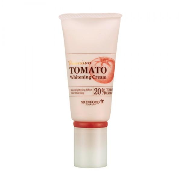 крем для лица осветляющий с экстрактом томата skin food  premium tomato whitening creamОсветляющий крем Premium Tomato Whitening Cream с экстрактом томата (20%) глубоко увлажняет, устраняет тусклый цвет лица, признаки усталости и стресса, предотвращает потерю влаги.<br><br>Содержит экстракт помидора, лактобактерии, керамиды, экстракты лотоса и софоры, витамин С и Е.<br><br>Регулярное использование данного корейского крема позволит избавиться от нежелательной пигментации, поможет выровнять тон кожи и ее структуру, обеспечит ей ухоженный и здоровый вид.<br><br>Витаминами Е, С, B предотвращают преждевременное старение кожи лица, обладают антисептическими свойствами, восстанавливают гладкость текстуры кожи.<br><br>Ликопин (содержится в экстракте томата), это органическое соединение, придающее плодам насыщенный красный цвет, является очень сильным натуральным антиоксидантом (превосходящим по своим свойствам таких признанных «ловцов свободных радикалов», как витамины С и Е). Обладает омолаживающим свойством, улучшают цвет лица, разглаживают морщины.<br><br>Керамиды — твердые или воскоподобные вещества липидной природы (сфинголипиды), которые совместно с холестерином и жирными кислотами образуют липидный барьерный слой кожи. При повреждении поверхностного слоя кожи керамиды заполняют бреши, образовавшиеся в результате вымывания, снижают проницаемость кожи, уменьшают потерю воды и улучшают упругость эпидермиса.<br><br>Экстракт лотоса обладает успокаивающим действием, укрепляет клетки кожи, содержит витамин С, нелумбин, нуфарин, арменавин.и минеральные соединения. Так же обладает биостимулирующим, общеукрепляющим, противовоспалительным действием, улучшает кровообращение. Стимулируют активность клеток кожи, замедляют процессы старения, предотвращают образование морщин и делают кожу гладкой и эластичной.<br><br>Экстракт софоры обладает высокими регенерирующими и антиоксидантными свойствами. Помогает коллагену кожи сохранять эластичность, способствует укреплению кожи, регулируе