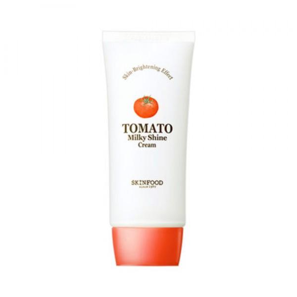крем для лица отбеливающий с экстрактом томата skin food  tomato milky shine creamTomato Milky Shine Cream. Крем для лица отбеливающий с экстрактом томата<br><br>365 дней в году чистая, свежая, сияющая кожа – крем с экстрактом томата от Skinfood поможет добиться такого результата. Крем предназначен для ежедневного применения в любое время года: и в летнюю жару, и в зимние дни, которые тоже могут «порадовать» возникновением пигментации.<br><br>Лучше всего томатный крем от Skinfood подходит для ухода за проблемной кожей, склонной к образованию акне, шелушению, образованию синюшных пятен и пигментации. Его действие направлено на осветление и выравнивание тона кожи, а также на предупреждение появления новых пигментных пятен. В составе крема экстракт томата, а также эффективный осветляющий компонент – ниацинамид.<br><br>Экстракт томата оказывает благотворное влияние на кожу лица, так как обладает питательными, увлажняющими, укрепляющими и тонизирующими свойствами, повышает упругость и эластичность, способствует выравниванию тона кожи, дарит лицу красивый ровный цвет. Также экстракт томата регулирует работу сальных желез, устраняет жирный блеск и сужает поры.<br><br>Ниацинамид обладает доказанной способностью осветлять пигментацию различного происхождения, корректирует неровный тон кожи и смягчает следы постакне и поствоспалительную гиперпигментацию. Кроме того, ниацинамид ускоряет жизненно важные процессы в клетках кожи, является мощным регулятором клеточного метаболизма, увеличивает синтез коллагена, керамидов и жирных кислот в поверхностном слое кожи, предотвращает потерю влаги, благодаря чему улучшается внешний вид сухой или поврежденной кожи, исчезают шелушения, восстанавливается однородность и целостность кожного покрова. Является сильным антиоксидантом, защищающим кожу от агрессивного воздействия ультрафиолета и свободных радикалов.<br><br>Способ применения: Нанести крем на кожу лица мягкими, массирующими движениями.<br><br>Объём: 50 мл<br>