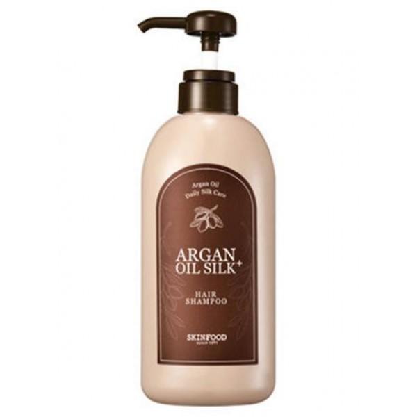 шампунь для волос с аргановым маслом skin food  argan oil silk plus shampooArgan Oil Silk Plus Shampoo.&amp;nbsp;Шампунь для волос с аргановым маслом<br><br>Шампунь, содержащий масло арганы, эффективно восстанавливает волосы, разглаживает и увлажняет их. Специальная формула обеспечивает бережное отшелушивание ороговевших частиц, стимулирует кровообращение, восстанавливает цвет, устраняет ломкость, а также ускоряет рост волос.<br><br>Шампунь содержит экстракт брокколи, люцерны, клубники, шпината, спаржи, асаи, клюквы, малины, оливы, макадами, шелка и арганы.<br><br>Масло арганы эффективно защищает волосы от пересыхания или, напротив, высокой влажности. Оно интенсивно питает, наполняет влагой и оживляет после окрашивания, горячих укладок или завивки.<br><br>Пептиды шелка – белки природного происхождения, благодаря им волосы обретают объем, блеск и приятный цвет.<br><br>При постоянном применении шампуня вы сможете решить проблему перхоти, вернуть им упругость и красоту. Шампунь имеет приятный аромат и упакован в красивую бутылку, которая станет настоящим украшением любой ванной комнаты. Удобная помпа-дозатор позволит без особых усилий набрать необходимое количество средства.<br><br>Способ применения: Шампунь вспенить на волосах, несколько минут помассировать, после чего смыть водой. При необходимости процедуру повторить.<br><br>Объем: 500 мл<br>